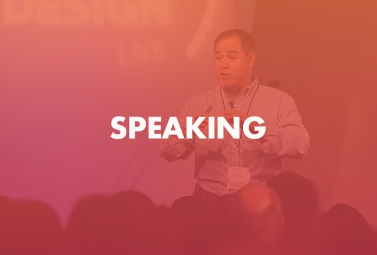 Jim Fortin speaking on stage to a crowd at a conference